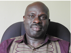 Dr. Mugume Sam Koojo,